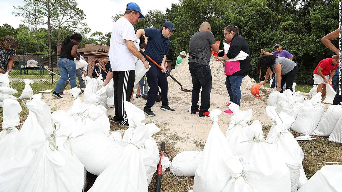 Dozens of Orange County residents fill sandbags at Blanchard Park in Orlando, Florida, on August 28.