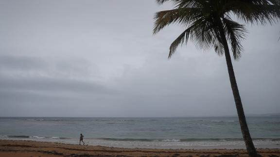 LUQUILLO, PUERTO RICO - AUGUST 28: A person is seen along the beach as Tropical Storm Dorian passes the island on August 28, 2019 in Luquillo, Puerto Rico. The Tropical Storm is expected to hit along the southeast coast as a possible category 2 hurricane.  (Photo by Joe Raedle/Getty Images)