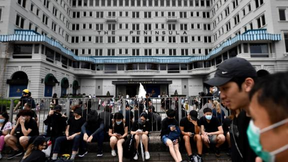 Protesters gathering in front of The Peninsula in Hong Kong. The hotel declined to comment on whether its business had been affected by a recent slowdown in the hospitality industry.