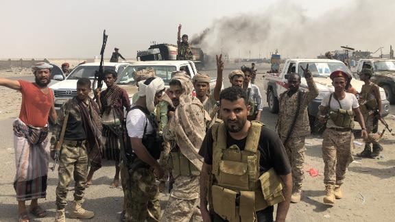 Fighters of the UAE-trained Security Belt Force, dominated by members of the Southern Transitional Council (STC) which seeks independence for south Yemen, flash the V-sign of victory at the al-Alam crossroads on the eastern entrance Aden from the Abyan province in southern Yemen on August 29, 2019. - Yemen's separatists have regained full control of the interim capital Aden following clashes with government forces who withdrew from the southern port city, security officials from both sides said. (Photo by Nabil HASAN / AFP)        (Photo credit should read NABIL HASAN/AFP/Getty Images)