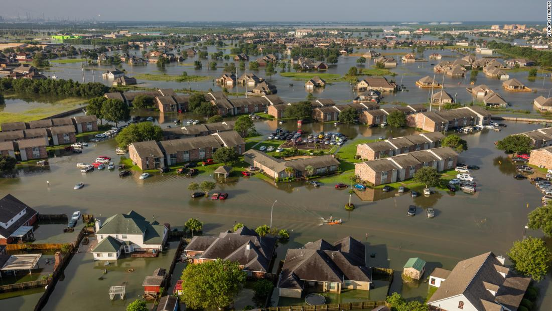 "A neighborhood is flooded in Beaumont, Texas, a day after <a href=""https://www.cnn.com/2017/08/26/us/gallery/hurricane-harvey/index.html"" target=""_blank"">Hurricane Harvey</a> came ashore in August 2017. The Category 4 storm caused historic flooding. It set a record for the most rainfall from a tropical cyclone in the continental United States, with 51 inches of rain recorded in areas of Texas. An estimated 27 trillion gallons of water fell over Texas and Louisiana during a six-day period. ""Warmer sea water from our changing climate is causing tropical storms to be more wet and powerful,"" photographer <a href=""https://georgesteinmetz.com/"" target=""_blank"">George Steinmetz</a> said."