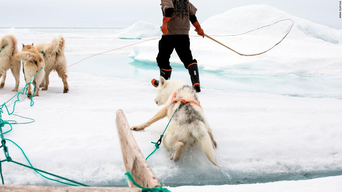 "Jorgen Umaq and his dogs traverse an icy area near Qaanaaq in northern Greenland. It is one of the northernmost towns in the world. Because ice thickness there has been declining, hunters like Umaq can't travel as far as they could before, said photographer <a href=""https://www.anfilip.com/"" target=""_blank"">Anna Filipova.</a> ""Navigating this terrain was dangerous and difficult,"" she said. ""We needed to manually move the sledge and twice needed to rescue the dogs who had fallen into the cracks in the sea. ... Each year, people lose their lives on the sea ice because of fast-changing conditions."""