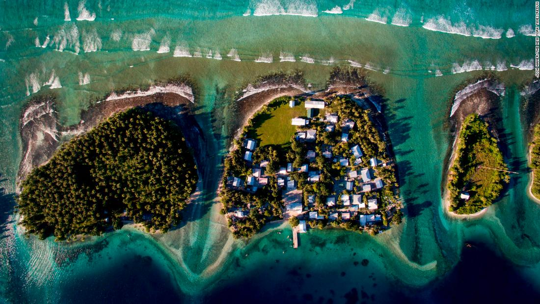 "This aerial photo shows Ejit, an islet in the Marshall Islands, in 2015. The islands are threatened by rising seas. ""I flew a drone above the island showing just how precarious its location is: Homes clinging to the edge of an eroding coastline as unrelenting waves chisel away at what remains,"" said <a href=""http://www.joshhaner.com/"" target=""_blank"">Josh Haner,</a> a photographer with The New York Times. ""After I saw what was happening on Ejit, I realized that climate change is not something nebulous that will only start affecting us in the future, but rather something happening right now. Residents are being forced to make the most difficult decision: Do they stay and build sea walls to buy some more time, or do they relocate?"""