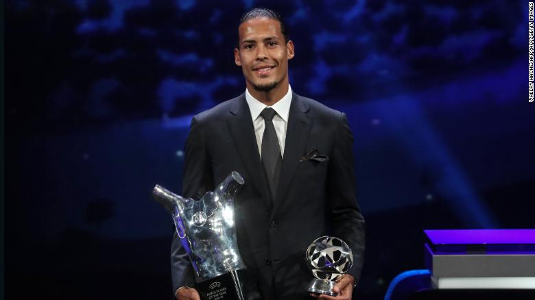 Liverpool's Dutch defender Virgil van Dijk poses with his trophies.
