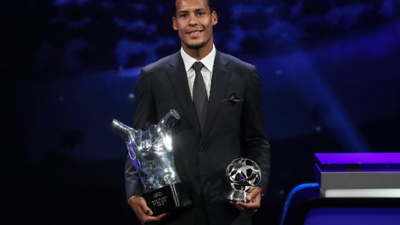 Liverpool's Dutch defender Virgil van Dijk poses with his trophies.