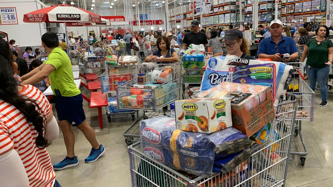 Shoppers wait in long lines at a Costco in Davie, Florida, on August 29.