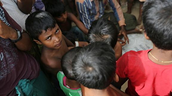 A Rohingya boy looks into the camera. According to the UN migration agency, men and boys account for about a third of Rohingya  forced into labor.