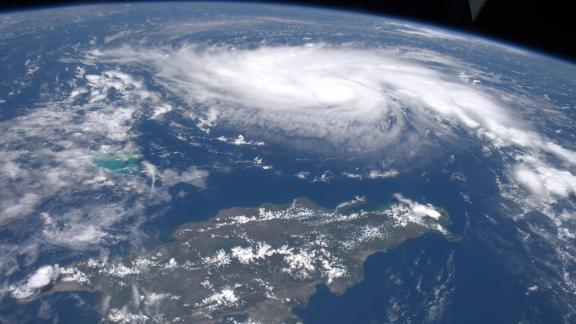 """""""Here's a look at #HurricaneDorian from @Space_Station,"""" Astronaut Andrew Morgan posted to Twitter on August 30. """"I caught this shot yesterday as it traveled across the Caribbean north of Haiti and the Dominican Republic.""""  https://twitter.com/AstroDrewMorgan/status/1167447150478934016"""