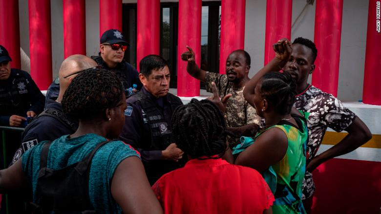 African migrants argue with the police guarding Siglo XXI immigration facility in Tapachula, Mexico. The migrants, some of whom speak English, French and/or Portuguese, are frustrated at the lack of help they have received to understand how to move forward legally to exit Mexico.