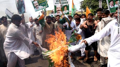 Pakistani demonstrators burn an effigy of Indian Prime Minister Narendra Modi during an anti-India protest rally in Peshawar on August 30, 2019. - Thousands rallied across Pakistan Friday in mass demonstrations protesting Delhi's actions in Indian-administered Kashmir in the most ambitious public protests targeting India in years. (Photo by ABDUL MAJEED / AFP)        (Photo credit should read ABDUL MAJEED/AFP/Getty Images)