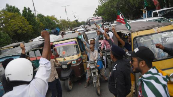 Pakistani policemen and commuters shout anti-Indian slogans during a traffic stoppage in Karachi on August 30.