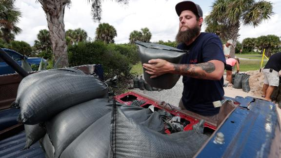 Matt Rohrer loads sandbags in the back of his vehicle in Flagler Beach, Florida, on Friday, August 30.