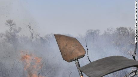 Firefighters try to control a fire near Charagua, Bolivia, on August 29, 2019.