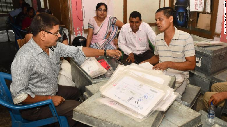 """In this photo taken on August 28, 2019, workers at the National Register of Citizens (NRC) office check documents submitted by people for the NRC ahead of the release of the register's final draft in Guwahati, the capital city of Indias northeastern state of Assam. - India's government sought August 29 to ease concerns about an imminent """"citizens' register"""" in the state of Assam that has left several million people, mostly Muslims, fearful of becoming stateless. (Photo by Biju BORO / AFP)        (Photo credit should read BIJU BORO/AFP/Getty Images)"""