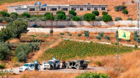 Lebanese Army and United Nations Transition forces in Lebanon patrol vehicles on the outskirts of the Lebanese village of Aitaroun.