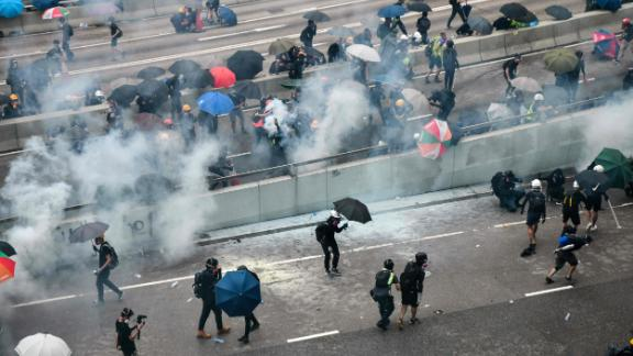An overhead view shows protesters reacting after police fired tear gas on August 31.