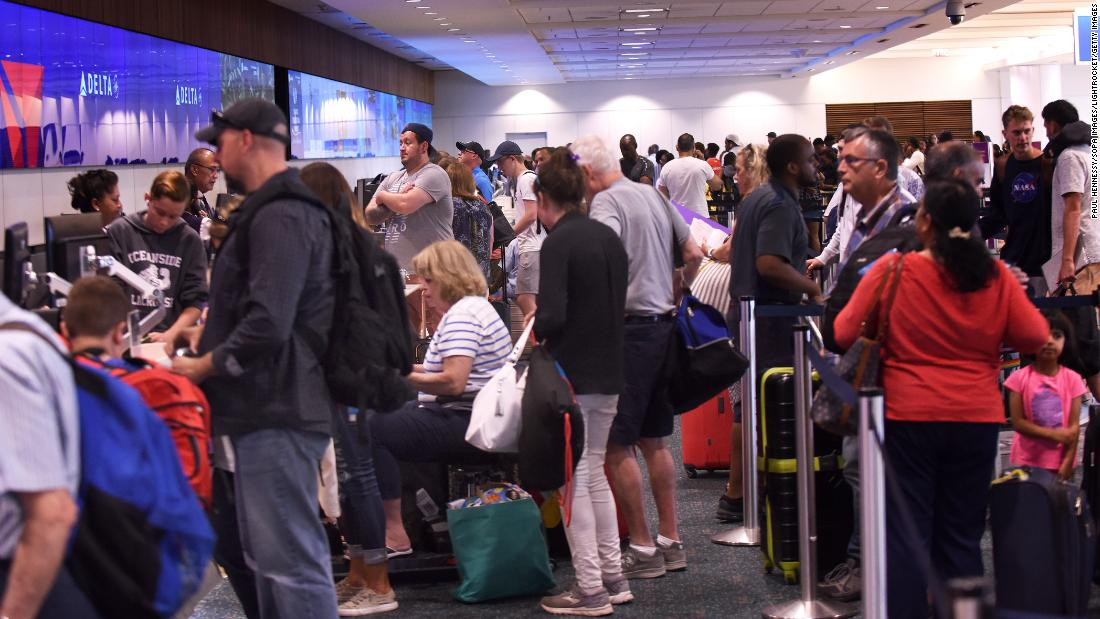 Passengers arrive at Orlando International Airport on August 31.