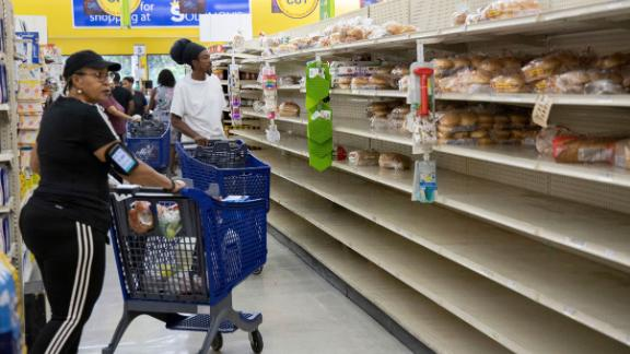 People shop for supplies before the arrival of Hurricane Dorian, in Freeport, Bahamas, on Friday.