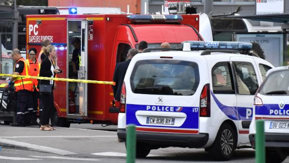 Emergency services at work on the outskirts of Lyon after a deadly knife attack.