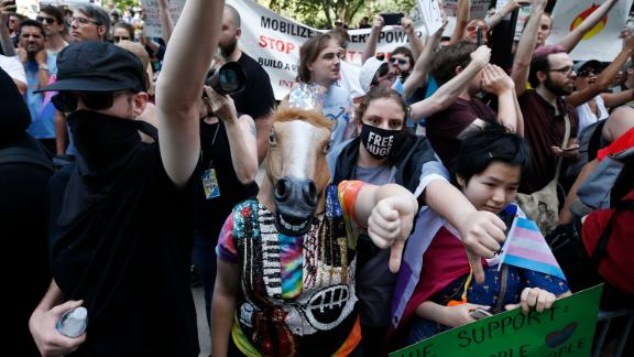 Counterprotesters, including one wearing a horse mask, lined the route of the Straight Pride Parade in Boston on Saturday, Aug. 31, 2019.