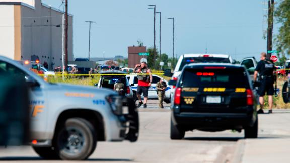 Texas police and sheriff's deputies surround an area behind Cinergy theater in Odessa after reports of shootings Saturday.
