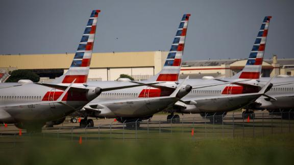 American Airlines Group Inc. Boeing Co. 737 Max planes sit parked outside of a maintenance hangar at Tulsa International Airport (TUL) in Tulsa, Oklahoma, U.S., on Tuesday, May 14, 2019. Three unions representing aviation safety inspectors said in a sharply worded report months before the Boeing's 737 Max was approved for use that the planemaker was given too much authority to oversee itself and that the new jet had safety flaws. Photographer: Patrick T. Fallon/Bloomberg via Getty Images
