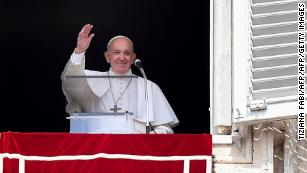 Pope Francis waves from the window of the apostolic palace on September 1.