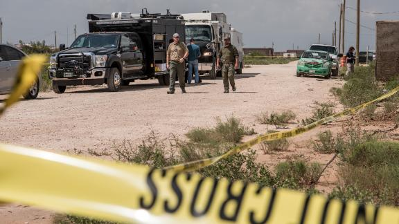 FBI agents search a home believed to be linked to a suspect following a deadly shooting spree on September 1, 2019 in West Odessa, Texas.
