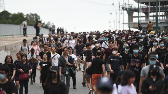 Crowds of protesters head from Hong Kong international airport to nearby Tung Chung.