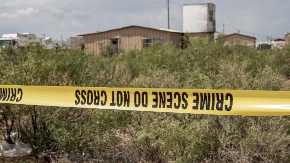 FBI agents search a home believed to be linked to Ator in West Odessa, Texas.