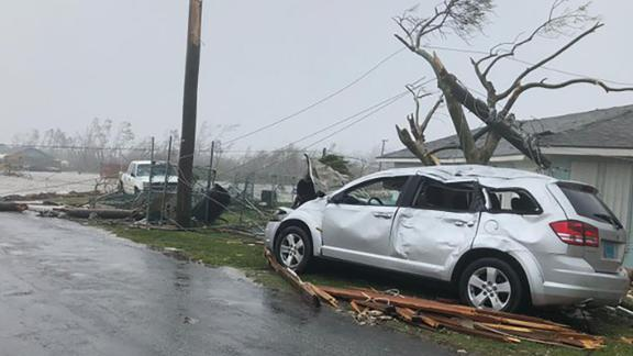 A damaged car sits amid the damage in Marsh Harbour, Bahamas.