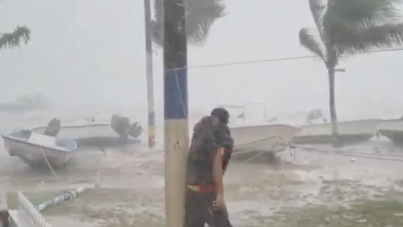 Earlyn Mills grapples with the storm on Harbour Island, Bahamas.