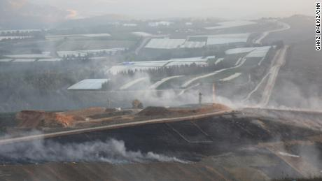 Fields near the border outside Maroun al-Ras were on fire after Israel struck Lebanese soil on Sunday.