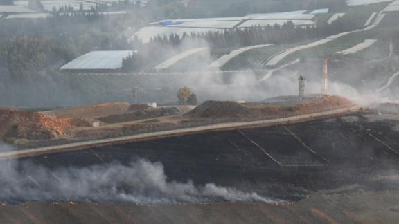 Fields near the border outside Maroun al-Ras were on fire after Israel struck Lebanese soil on Sunday.