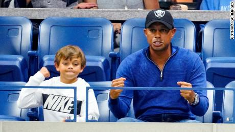 Tiger Woods and his son Charlie Axel Woods cheer on Rafael Nadal at the US Open in New York.