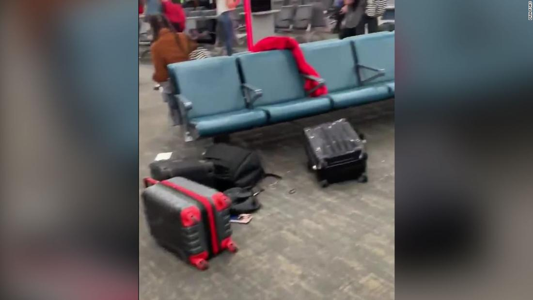 An airline employee thought two men at Newark airport looked suspicious so she yelled for people to evacuate