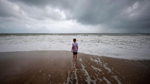 A boy stands near high surf in Vero Beach, Florida, on September 2.