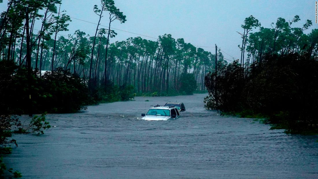 A car is submerged in floodwaters in Freeport, Bahamas, on September 3.