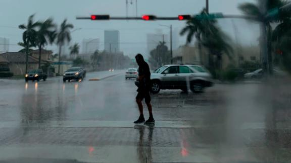 A man crosses a street during a downpour in Fort Lauderdale, Florida, on September 2.