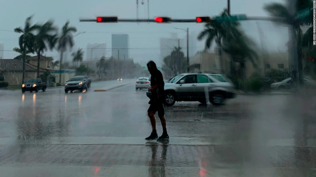 A man crosses the street during a downpour in Fort Lauderdale, Florida, on September 2. The hurricane's outer bands had already started hitting the state.