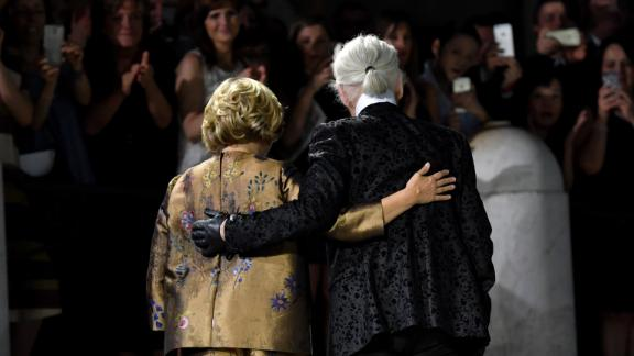 German designer Karl Lagerfeld and Silvia Fendi acknowledge the audience at the end of the Fendi fashion show at the Trevi Fountain in Rome, in 2016.