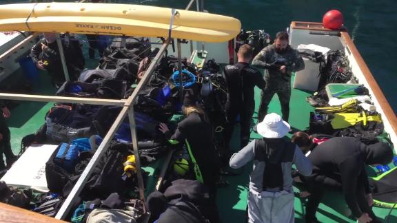 File footage from 2018 shows divers on board the Conception.
