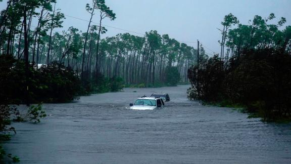 Cars sit submerged in water Tuesday in Freeport.