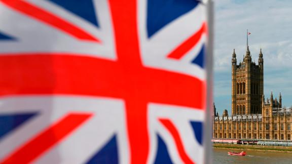 The Palace of Westminster housing the Houses of Parliament is seen from Westminster Bridge with a Union Flag in the foreground in central London on August 28, 2019 - British Prime Minister Boris Johnson announced Wednesday that the suspension of parliament would be extended until October 14 -- just two weeks before the UK is set to leave the EU -- enraging anti-Brexit MPs. (Photo by DANIEL LEAL-OLIVAS / AFP)        (Photo credit should read DANIEL LEAL-OLIVAS/AFP/Getty Images)