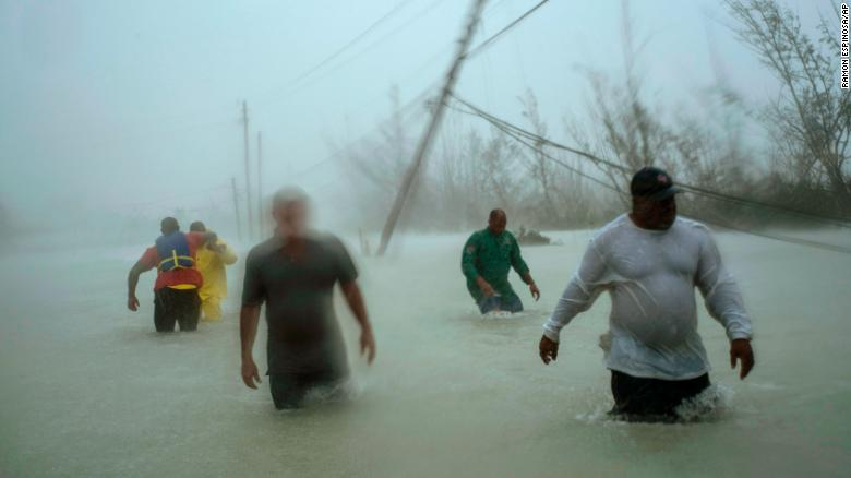 Volunteers tried to rescue families Tuesday in Freeport, on the island of Grand Bahama.