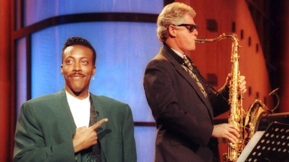 "Talk show host Arsenio Hall gestures approvingly as Clinton plays the saxophone during a taping of ""The Arsenio Hall Show"" in 1992. Clinton was running for president at the time."