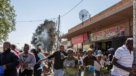 Looters run from a shop in Turffontein, east of Johannesburg, on September 2, 2019.