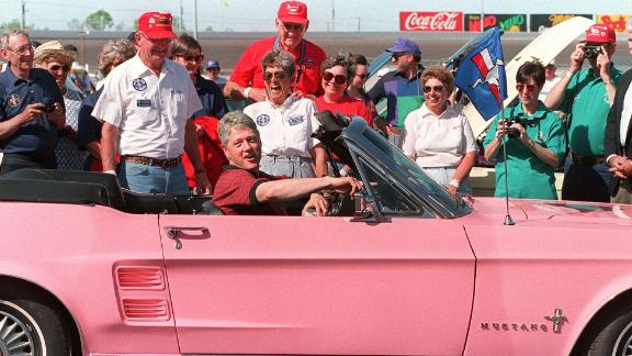 Clinton sits in a 1967 Ford Mustang while visiting the Charlotte Motor Speedway in North Carolina in April 1994.