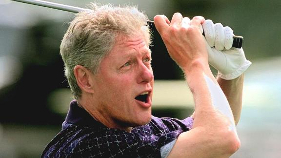 Clinton tees off while playing golf at Martha's Vineyard in Massachusetts in August 1997.