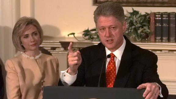 "Clinton speaks about the Monica Lewinsky scandal at the White House in January 1998, as first lady Hillary Clinton looks on. ""I did not have sexual relations with that woman,"" he said."